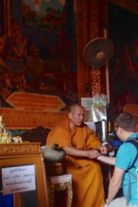 Andrew getting blessed by a monk